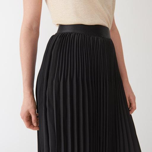 svart plisserad kjol