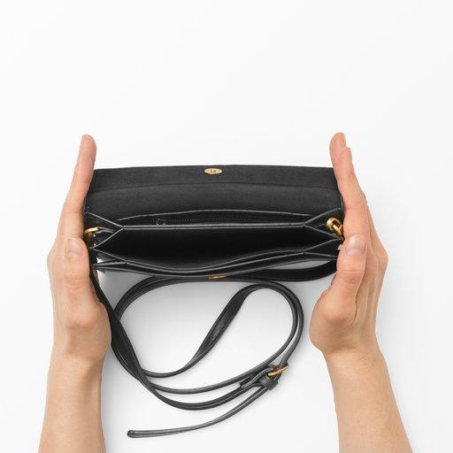 liten handväska skinn